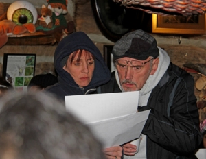 Alicia and Andrew Phillips review a winter star chart before leaving Red Fox Cabin for the trails.